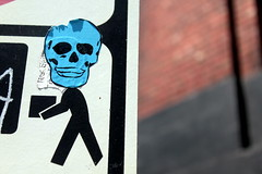 Skull Head Delivery (See El Photo) Tags: street city blue urban 15fav favorite usa color art face sign oregon digital canon eos skull sticker stickerart colorful stuck box body head or streetsign urbanart signage stick bone fav carry carrying blackline t1i chrislaskaris