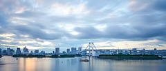 Tokyo Bay (Alisonfd) Tags: city longexposure travel bridge light sky water japan clouds reflections landscape japanese tokyo evening boat long exposure cityscape tokyobay rainbowbridge waterscape