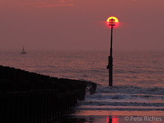 AA234499 : Birth of the Sun King (pete riches) Tags: sea beach sunrise dawn seaside sand frost waves cliffs resort seawall erosion northsea promenade flotsam eastcoast groynes eastyorkshire hornsea cretaceous breakwaters holderness seadefences coastalerosion peteriches