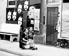 There Goes the Fear Again (kirstiecat) Tags: street people blackandwhite streetart chicago pasteup monochrome graffiti lyrics child mother strangers surreal son logansquare