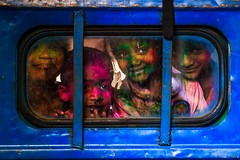 Smiling Colors - Bengaluru, India (Kartik Kumar S) Tags: holi bangalore karnataka india colors glass canon 600d 50mm kids children smile window shape festival faces