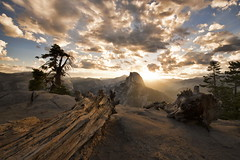 Half Dome Full Sunrise (Greg - AdventuresofaGoodMan.com) Tags: california park wood trees usa sun mountain nature clouds sunrise nationalpark log yosemite halfdome yosemitenationalpark glacierpoint powerfulsky