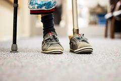 Possibilites (glusacasver) Tags: feet canon hospital walking children war legs walk help rockets crutches prada success prosthetic amputees