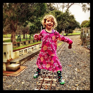 """365/228 • at the miniature steam engines today - we are back in the land of, """"Not comfy!"""" Which means she tries on 14 different things before she might find something tolerable. Like her sister's dress, teamed with gumboots. Other than that, she's command"""