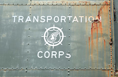 Transportation Corps (Samantha Evans of Samantha Evans Photography) Tags: railroad red brown white green texture lines wheel metal museum train canon ga vintage emblem georgia word army design words rust peeling paint rivets pattern ship panel streak patterns painted military letters railway trains line crack textures badge rusted letter traincar shield aged insignia winged chipped duluth corrosion cracked steeringwheel corroded militaria usarmy rivet carwheel repeatingpatterns duluthga repeatingpattern southeasternrailwaymuseum canon24105 canon6d armytransportationcorps usarmytransportationcorps usarmytransportationcorpsinsignia wingedcarwheel armytransportationcorpsinsignia