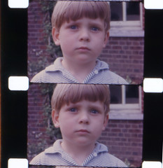 Quiet moment (theirhistory) Tags: boy colour film face child head 16mm