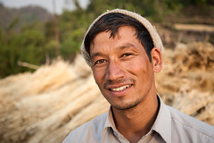 Portrait of Indian man in front of harvest (damonlynch) Tags: people india man male men person asia adult masculine indian harvest human crop crops agriculture humanbeing magichour humans practices goldenhour humanbeings harvesting southasia southasian agronomy champawat uttarakhand shyamlatal