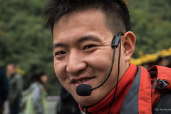 2016 - China - Yangtze River - Goddess Stream Tour Guide Jason (Ted's photos - For Me & You) Tags: 2016 china cropped goddessstream nikon nikond750 nikonfx shennvstream tedmcgrath tedsphotos vignetting yangtzeriver portrait pose posing headset smile dents teeth bokeh face microphone mike mouthpiece