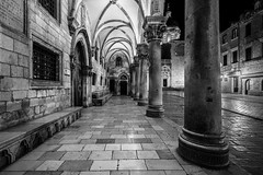 Rector's Palace (McQuaide Photography) Tags: dubrovnik croatia hrvatska dalmatia ragusa europe sony a7rii ilce7rm2 alpha mirrorless 1635mm sonyzeiss zeiss variotessar fullframe mcquaidephotography adobe photoshop lightroom tripod wideangle wideanglelens longexposure oldtown street urban city blackandwhite blackwhite bw mono monochrome old oldstreet oldbuilding medieval middleages character atmosphere rectorspalace kneževdvor architecture renaissancestyle porch columns history historic historical historicalbuilding nopeople unesco unescoworldheritage heritage oldplace night nightphotography