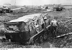 Tracked vehicle Kleist's Panzer Group crossed muddy creek in a Soviet village.