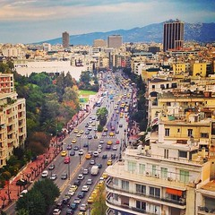 Athens and the winter. (612gr) Tags: summer urban streets cars yellow square greek town traffic centre hellas sunny center athens taxis skyscrappers greece busy squareformat mayfair 612 sixtwelve iphone5 iphoneography 612gr instagramapp uploaded:by=instagram webstagram
