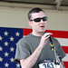 Bryan Adams, a Purple Heart recipient, Rutgers University veterans' advocate and a founder of the Jeremy Kane Memorial Run, addresses the runners.  Photo Credit: Javier Diaz