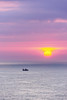 seascape with fishing ship at sunset (Mimadeo) Tags: ocean sunset red sea sky orange sun color water beautiful silhouette sunrise landscape golden evening boat colorful waves ship dusk magenta lavender vessel calm rays sunrays beams sunbeams fishingship