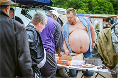 Fat Salesman (Tomas.Kral) Tags: people man canon 50mm fat belly fleamarket salesman 5dmarkii