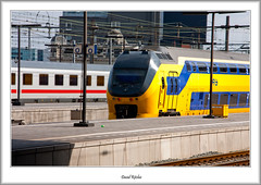 Double Decked Commuter Train (flatfoot471) Tags: urban netherlands dutch station amsterdam electric landscape spring rail centralstation