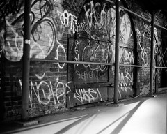 dumbo street (september.) Tags: street nyc newyorkcity sunset blackandwhite bw film brooklyn 35mm graffiti scaffolding afternoon shadows dumbo sunny rangefinder yashicaelectro35 kodaktmax100