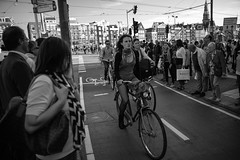 Amsterdam street (angheloflores) Tags: street people woman netherlands amsterdam bike bicycle walking calle traffic gente bicicleta holanda fiets straat mensen blackadnwhite