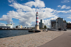 Lighthouse By The Bridge (Rutger Blom) Tags: bridge sky lighthouse water clouds malmö vatten malmo fyr cobbledstones fav10 26mm canoneos5dmarkii universitetsbron ef2470mmf28liiusm