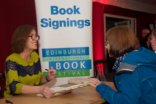 Kirst Wark signs books for her vans