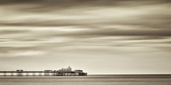 Llandudno Pier (S.R.Murphy) Tags: longexposure sunset sea blackandwhite bw seascape heritage history beach water monochrome wales canon mono evening coast pier cloudy llandudno conwy lightroom 16x9 northwales canon24105mmf4l coastallandscape leefilters 16x9crop canon6d nikdfine 50favourites niksilverefexpro2 aug2014