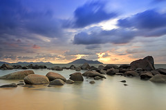 Sunrise and Sunset in Singkawang, West Kalimantan, Indonesia (Sassy Chris) Tags: seascape beach indonesia landscape rocks borneo kalimantan singkawang