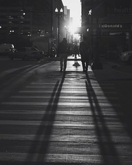 walking away (Kenny C Photography) Tags: city morning shadow people blackandwhite sun sunlight chicago sunrise illinois streetphotography windy sunburst wackerdrive downtownchicago kennycphotography