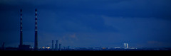 Catching the Light (Owen J Fitzpatrick) Tags: ojf people photography nikon fitzpatrick owen j joe pretty pavement chasing d3100 ireland editorial use only ojfitzpatrick eire dublin republic city tamron poolberg chimney pipe huge old structure landmark power electricity station poolbeg sky landscape 600ft 600 feet tall towers ballymun block urban plan northside northcider skyline cityscape light santry hotel metro airport rain squall heavy street dslr digital streetphotography streetphoto irish