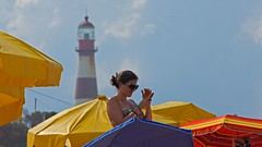 IMG_6267 The lady and the lighthouse (Rodolfo Frino) Tags: beachumbrella beach sand bright color colors colour colours colorful colourful sky cloud clouds girl woman mujer lighthouse catchycolors yellow red blue phone cellphone mobile mobil lady ciel cielo lightblue orange bikini brunette summertime summer happy