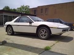 '84 Pontiac Fiero, For Sale (artistmac) Tags: white car illinois automobile gm forsale belleville il fiero pontiac rough sportscar generalmotors rwd alloywheels midengine faircondition