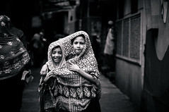 Together... (Scare-Crow) Tags: street girls people smile kids nikon candid lifestyle shy hood positive dhaka moment potrait bangladesh bnw 85mmf18 d90 goale