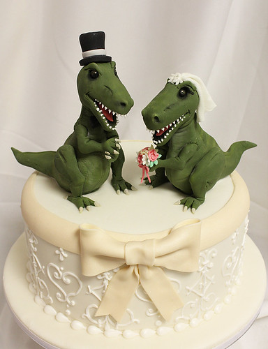 Trex bride groom wedding cake