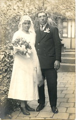 Just married (elinor04 thanks for 25,000,000+ views!) Tags: old flowers 1920s wedding portrait woman man fashion vintage studio real groom bride photo backyard couple hungary photographer veil post young style card age oldphotograph magyar foundphoto atelier hungarian foundphotos magyarorszg vintagephoto szentendre weisz foundphotographs bygone rppc mterem bygoneage elinorsvintagephotocollection weiszjzsef hungarianstudio weiszj magyarmterem magyarfnykpsz