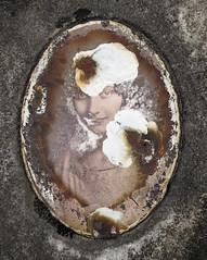 Damaged ceramic photograph of a woman (Monceau) Tags: woman sepia ceramic photograph damaged cimetiredegrenelle