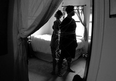 our ties (series) (peculiarnothings) Tags: portrait blackandwhite bedroom couple wrap yarn relationship bond string trap connection