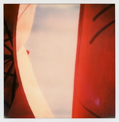 Red Umbrellas (tobysx70) Tags: santa street new red toby sky abstract color film project mexico polaroid sx70 for restaurant swiss south bistro tip cameras bakery type instant fe sonar hancock nm guadalupe pastries umbrellas impossible the sx70sonar impossibleproject polawalk tobyhancock impossaroid 061414