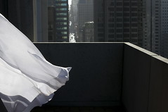Checking Out (blueteeth) Tags: city balcony air elements highrise breeze drapes