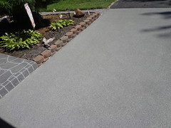 GraniFlex Driveway - Along Landscaping Border (Decorative Concrete Kingdom) Tags: flake overlay rubber chips driveway approach flakes membrane resurfacing polyaspartic crackproof graniflex