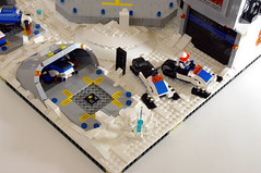 Drone in revetment & jumping in a snowmobile - Visiting the Ice Planet (jskaare) Tags: snow ski ice lego space pad cargo landing creation shuttle planet spaceship custom artic base own snowmobile outpost moc drone pinnace