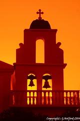 Greek Orthodox Glow (Holfo) Tags: sunset orange tower church architecture bells religious greek islands nikon san mediterranean glow arch cross outdoor belltower greece filter crucifix orthodox corfu ionianislands aghios stephanos d5100
