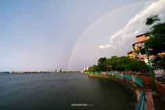 Rainbow over lake (:: Focus Studio ::) Tags: sunset roses summer vacation panorama lake reflection tree tower tourism church reed water beautiful clouds island town rainbow pond quiet village view little gorgeous traditional small saxony feel sunny scene east vietnam spire westlake romantic typical hanoi idyllic wittichenau