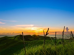 Sunset over the Hills (Pipo De Jesus) Tags: 500px vayang batanes philippines hills sunset sunsets sea serenity peace end day god nature beauty golden hour sun green mountain fences fence hope love sky skies orange yellow blue dusk