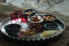 Tea with Dried cherries, walnuts, nuts, cookies abd dates