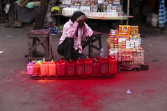 Red color seller (Scalino) Tags: street trip travel red india color asia kolkata bengal seller calcutta bengali westbengal cheesenaan
