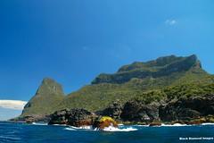 Side of Mt Gower & Back of Mt Lidgbird - Lord Howe Island Circumnavigation (Black Diamond Images) Tags: mountains island boat paradise australia cliffs nsw boattrip circumnavigation lordhoweisland worldheritagearea mtgower mtlidgbird thelastparadise circleislandboattour