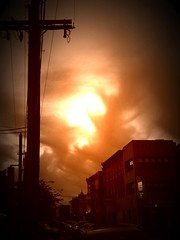 It's Here (Xrayeye) Tags: street shadow red clock philadelphia silhouette clouds buildings wire boom redsky poll iphone firesky skyfall