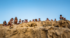 Seers (janwellmann) Tags: sunset summer cliff sun holiday spain rocks makeup chilling ibiza groupportrait mime groupofpeople enjoying overhang onlookers vibe beachgoers