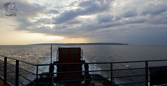 Wabana Bell Island (gordjohnson) Tags: ocean trip sunset water clouds newfoundland dark boat bellisland coldwaves