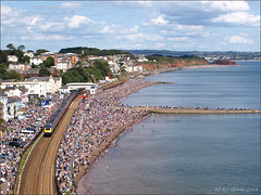 Busy town (ExeDave) Tags: uk sea england cliff seascape beach station train landscape coast sandstone aircraft crowd transport first rail railway august cliffs airshow devon gb crowds 125 hst 2014 dawlish greatwestern teignbridge langstonerock leamount p8234541
