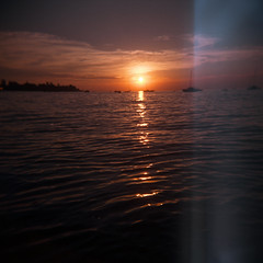 lake constance sunset (mathias-erhart) Tags: holga bodensee lakeconstance bregenz lake water wave waves cloud clouds sun reflection sunset dusk boat boats ship ships silhouette silhouettes film kodakektar100