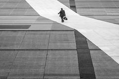 Paris, France (gstads) Tags: puteaux îledefrance france fr paris ladéfense défense defense bw blackandwhite lines geometry man bag male street streetphotography streetscene path monochrome blackwhite noiretblanc parisian parisien french français bnw